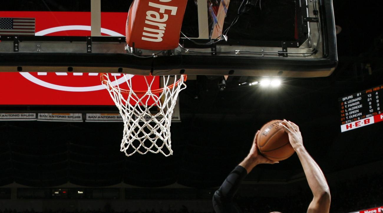 SAN ANTONIO, TX - NOVEMBER 18: LaMarcus Aldridge #12 of the San Antonio Spurs grabs the rebound against the Denver Nuggets on November 18, 2015 at the AT&T Center in San Antonio, Texas.