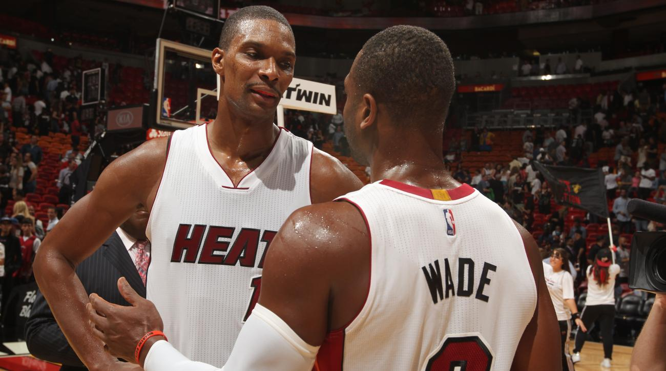 MIAMI, FL - NOVEMBER 19:  Chris Bosh #1 of the Miami Heat celebrates after the game against the Sacramento Kings with Dwyane Wade #3 of the Miami Heat on November 19, 2015 at AmericanAirlines Arena in Miami, Florida. (Photo by Issac Baldizon/NBAE via Gett