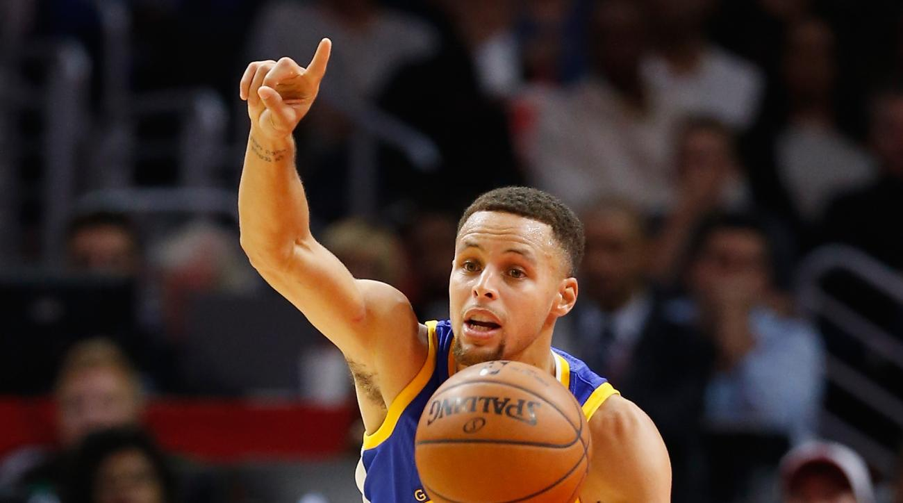 LOS ANGELES, CA - NOVEMBER 19:  Stephen Curry #30 of the Golden State Warriors dribbles the ball during the first half of a game at Staples Center on November 19, 2015 in Los Angeles, California. (Photo by Sean M. Haffey/Getty Images)