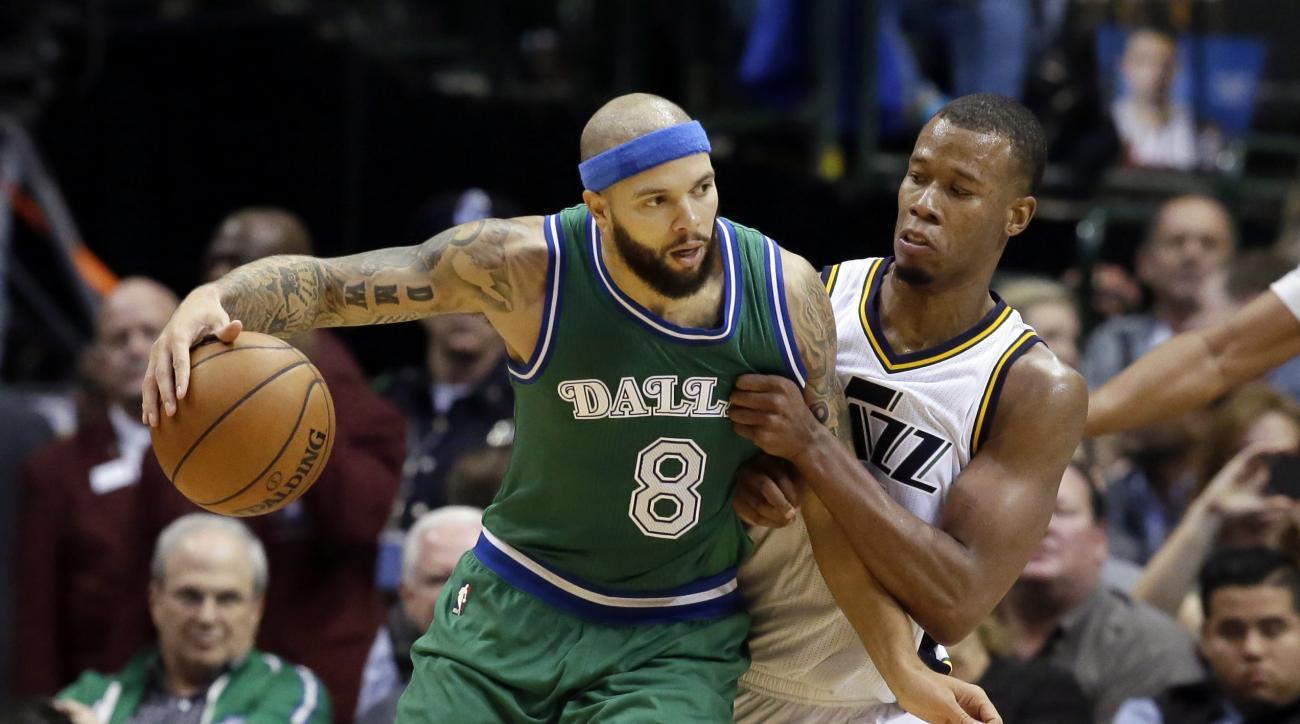 Dallas Mavericks guard Deron Williams (8) dribbles against Utah Jazz guard Rodney Hood during the second half of an NBA basketball game Friday, Nov. 20, 2015, in Dallas. The Mavericks won 102-93. (AP Photo/LM Otero)