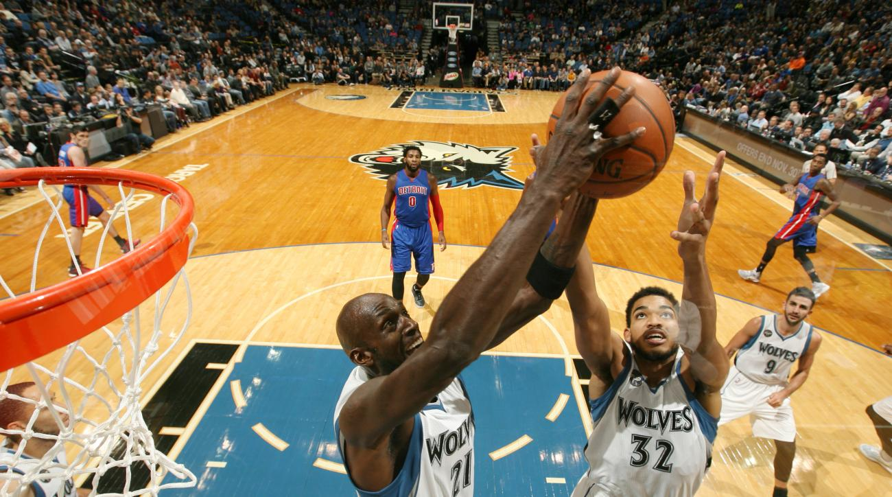 MINNEAPOLIS, MN -  NOVEMBER 20:  Kevin Garnett #21 of the Minnesota Timberwolves and Karl-Anthony Towns #32 of the Minnesota Timberwolves go after a rebound against the Detroit Pistons on November 20, 2015 at Target Center in Minneapolis, Minnesota. (Phot