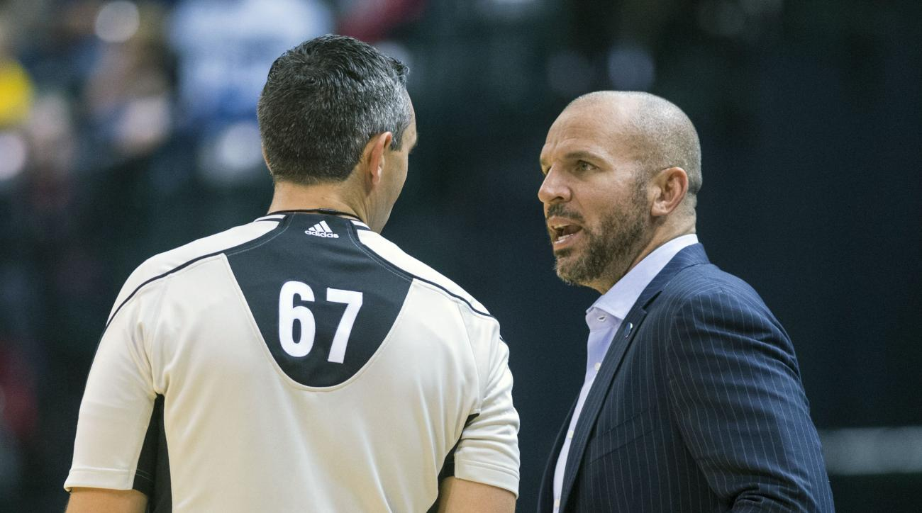 Milwaukee Bucks head coach Jason Kidd talks with referee Brett Nansel (67) during the first half of an NBA basketball game, Saturday, Nov. 21, 2015, in Indianapolis. (AP Photo/Doug McSchooler)