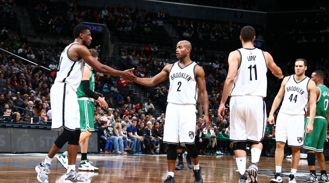 BROOKLYN, NY - NOVEMBER 22:   Jarrett Jack #2 of the Brooklyn Nets shakes hands with Thaddeus Young #30 of the Brooklyn Nets during the game against the Boston Celtics on November 22, 2015 at Barclays Center in Brooklyn, New York. (Photo by Nathaniel S. B