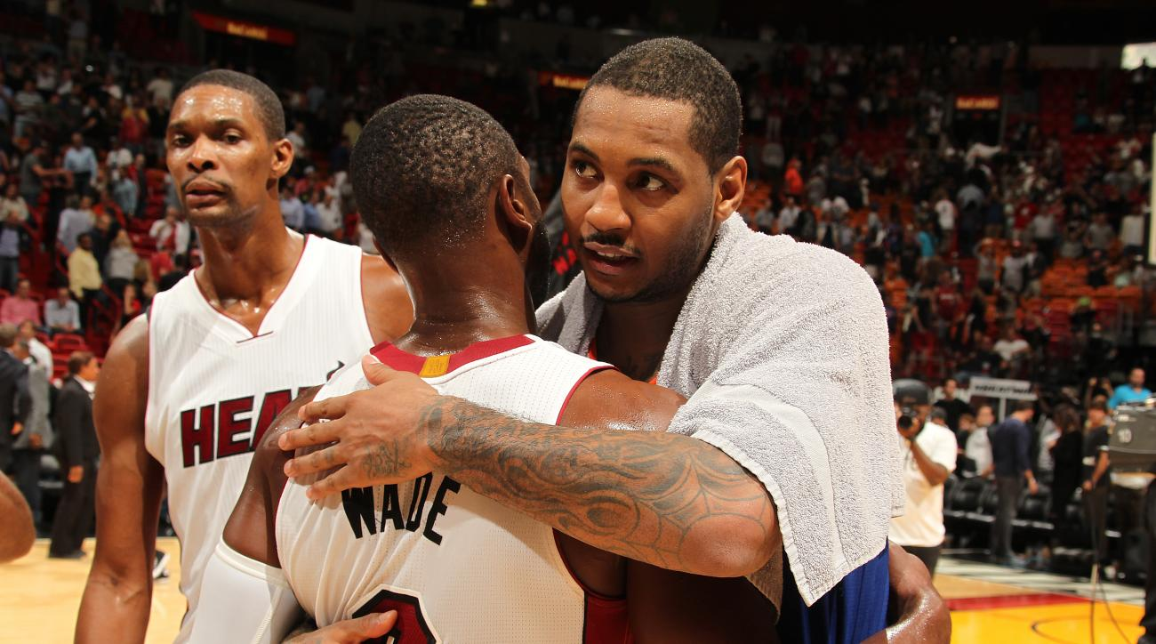 MIAMI, FL - NOVEMBER 23:  Carmelo Anthony #7 of the New York Knicks hugs Dwyane Wade #3 of the Miami Heat after the game on November 23, 2015 at American Airlines Arena in Miami, Florida. (Photo by Issac Baldizon/NBAE via Getty Images)