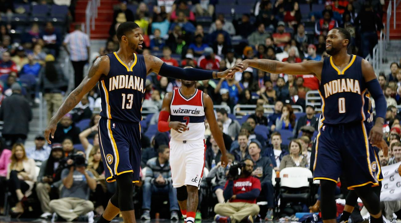WASHINGTON, DC - NOVEMBER 24: Paul George #13 and C.J. Miles #0 of the Indiana Pacers celebrate during the closing minute of the Pacers 123-106 win over the Washington Wizards at Verizon Center on November 24, 2015 in Washington, DC. (Photo by Rob Carr/Ge