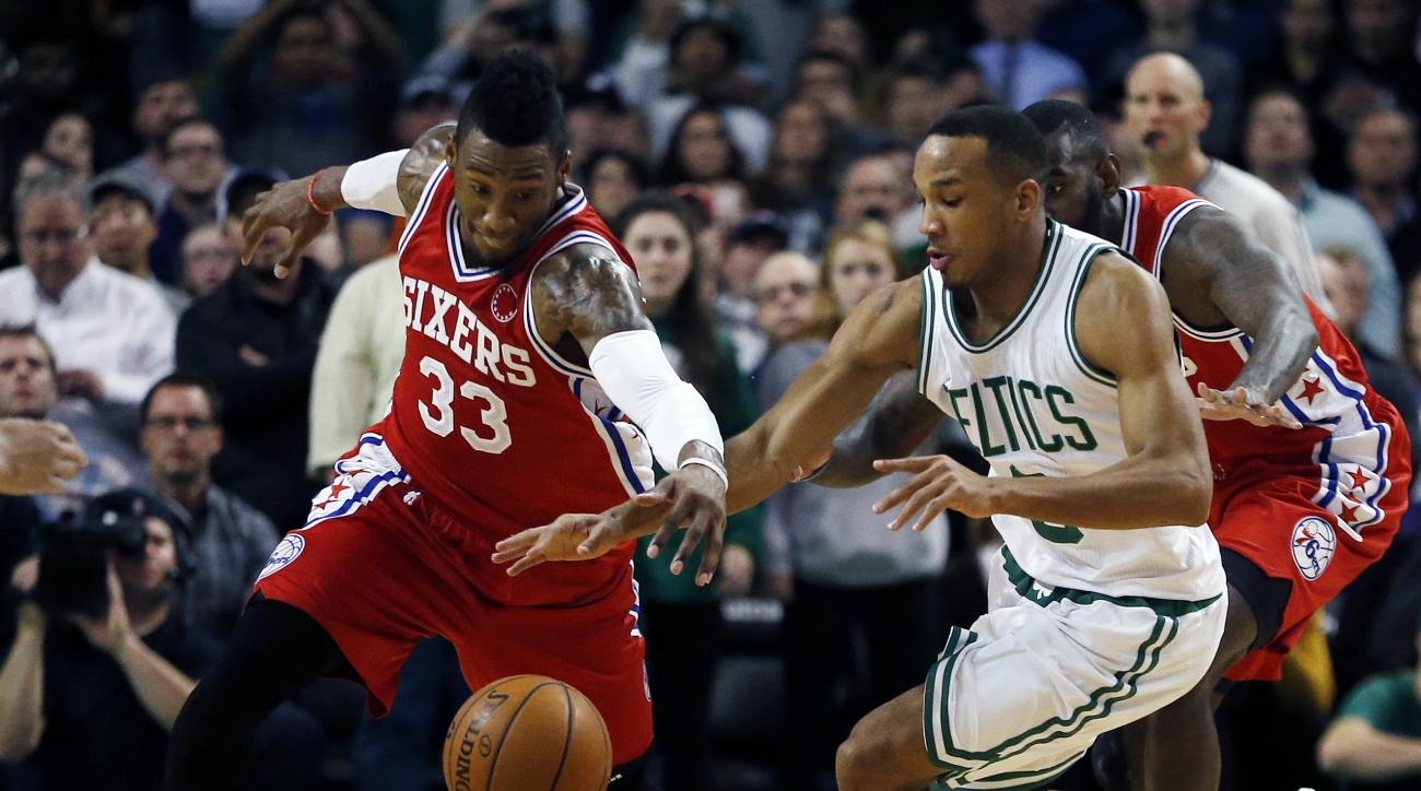 Philadelphia 76ers' Robert Covington (33) and Boston Celtics' Avery Bradley (0) chase a loose ball during the fourth quarter of an NBA basketball game in Boston, Wednesday, Nov. 25, 2015. The Celtics won 84-80. (AP Photo/Michael Dwyer)