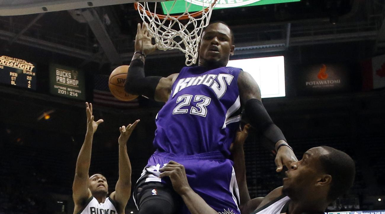 Milwaukee Bucks' Khris Middleton (22) passes to Jabari Parker (12) for a dunk in front of Sacramento Kings' Ben McLemore (23) during the second half of an NBA basketball game Wednesday, Nov. 25, 2015, in Milwaukee. (AP Photo/Morry Gash)