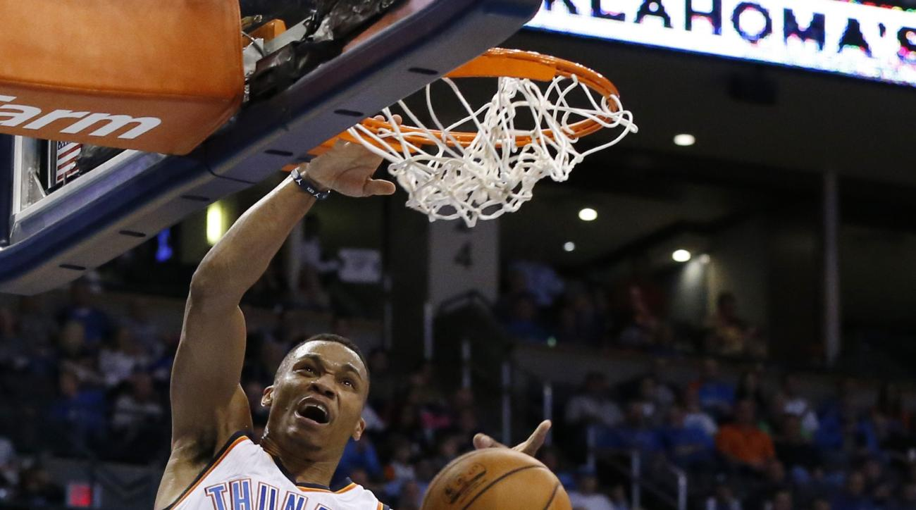 Oklahoma City Thunder guard Russell Westbrook (0) dunks over Brooklyn Nets center Brook Lopez (11) during the third quarter of an NBA basketball game in Oklahoma City, Wednesday, Nov. 25, 2015. Oklahoma City won 110-99. (AP Photo/Sue Ogrocki)