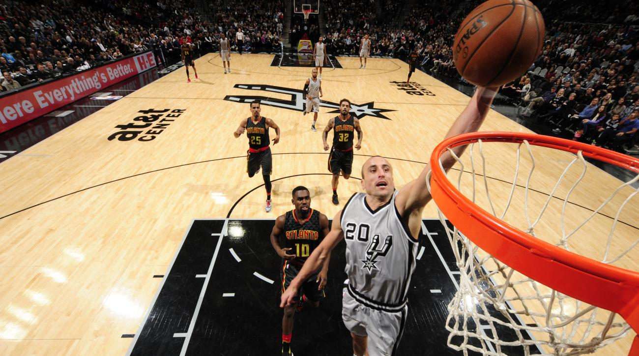 SAN ANTONIO, TX - NOVEMBER 28:  Manu Ginobili #20 of the San Antonio Spurs goes to the basket against the Atlanta Hawks on November 28, 2015 at the AT&T Center in San Antonio, Texas.