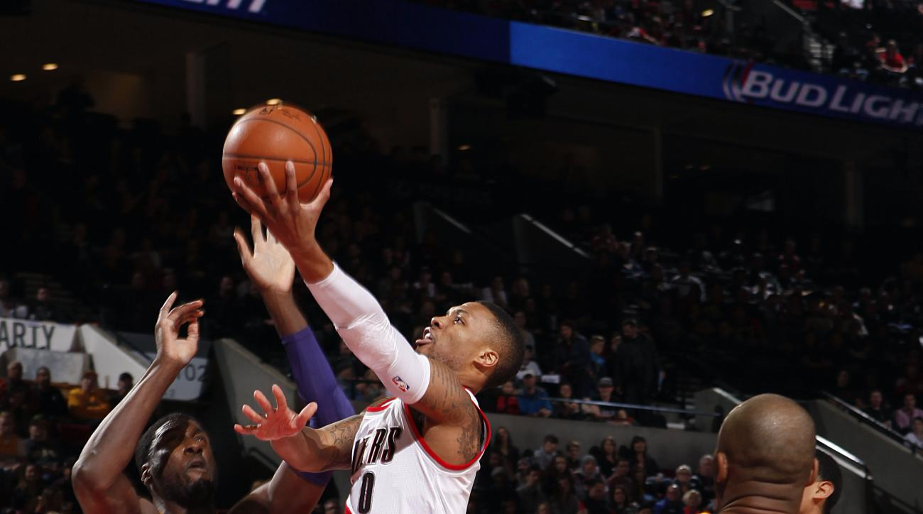 PORTLAND, OR - NOVEMBER 28:  Damian Lillard #0 of the Portland Trail Blazers goes for the lay up during the game against the Los Angeles Lakers on November 28, 2015 at the Moda Center in Portland, Oregon. (Photo by Cameron Browne/NBAE via Getty Images)