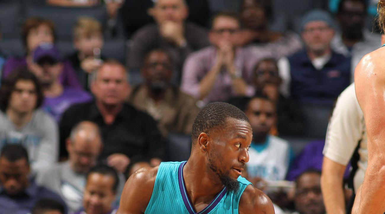 CHARLOTTE, NC - NOVEMBER 29: Kemba Walker #15 of the Charlotte Hornets handles the ball during the game against the Milwaukee Bucks on November 29, 2015 at Time Warner Cable Arena in Charlotte, North Carolina. (Photo by Brock Williams-Smith/NBAE via Getty