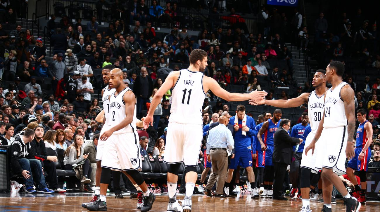 BROOKLYN, NY - NOVEMBER 29:  Brook Lopez #11 of the Brooklyn Nets shakes hands with his teammates during the game against the Detroit Pistons on November 29, 2015 at Barclays Center in Brooklyn, New York. (Photo by Nathaniel S. Butler/NBAE via Getty Image