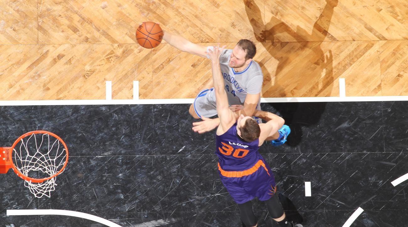 BROOKLYN, NY - DECEMBER 1: Bojan Bogdanovic #44 of the Brooklyn Nets goes for the lay up against Jon Leuer #30 of the Phoenix Suns during the game on December 1, 2015 at Barclays Center in Brooklyn, New York. (Photo by Nathaniel S. Butler/NBAE via Getty I