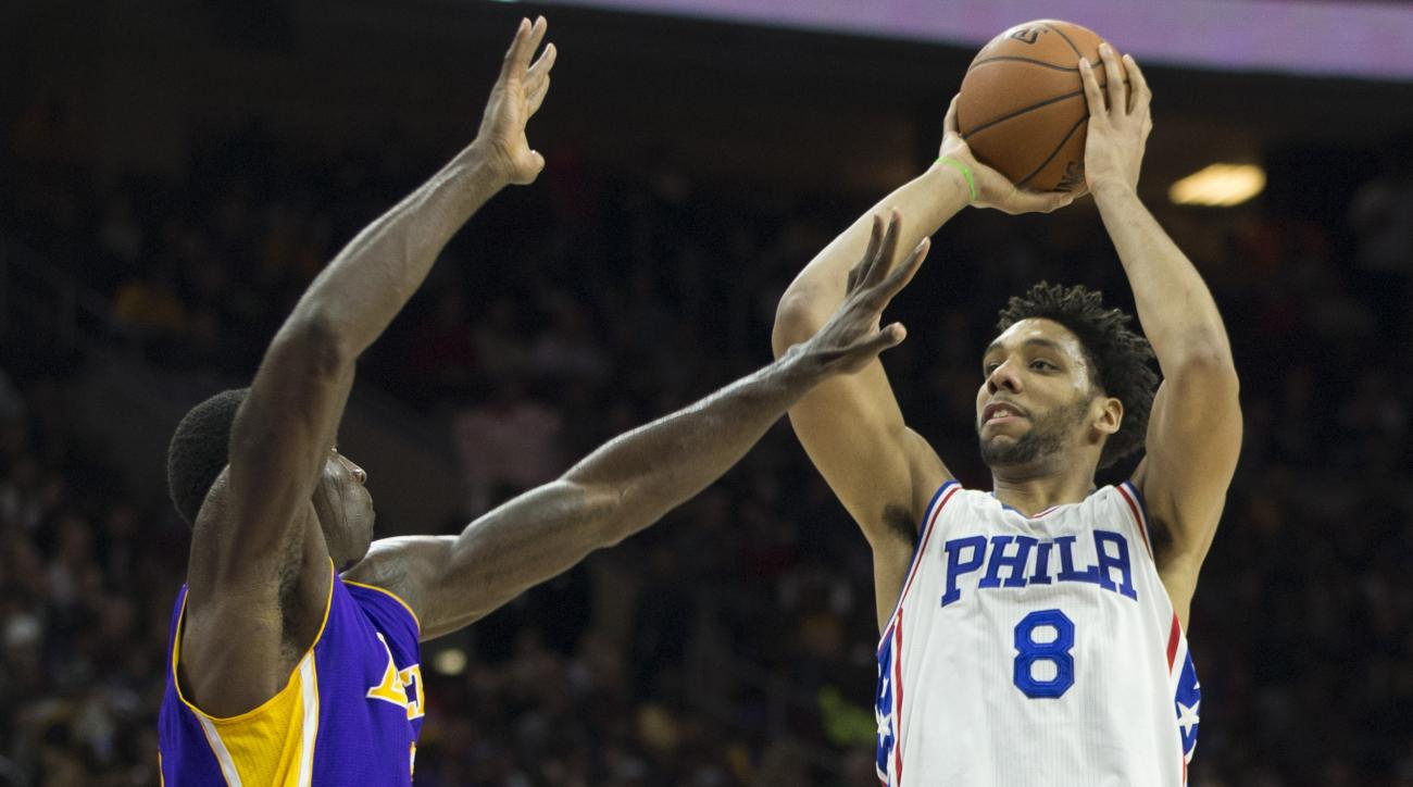 PHILADELPHIA, PA - DECEMBER 1: Jahlil Okafor #8 of the Philadelphia 76ers attempts a shot over Brandon Bass #2 of the Los Angeles Lakers on December 1, 2015 at the Wells Fargo Center in Philadelphia, Pennsylvania. (Photo by Mitchell Leff/Getty Images)