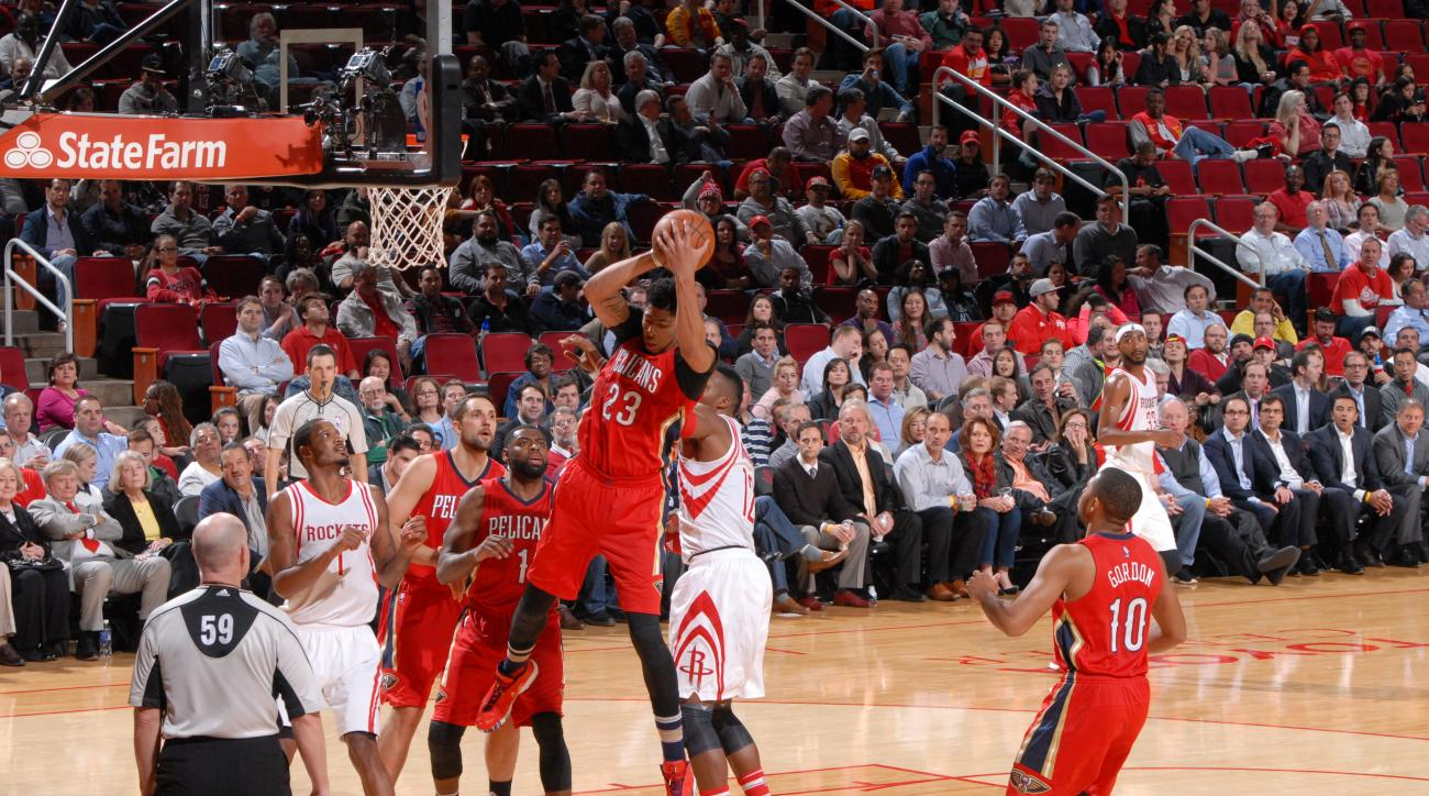 HOUSTON, TX - DECEMBER 2:  Anthony Davis #23 of the New Orleans Pelicans grabs the rebound against the Houston Rockets on December 2, 2015 at the Toyota Center in Houston, Texas. (Photo by Bill Baptist/NBAE via Getty Images)
