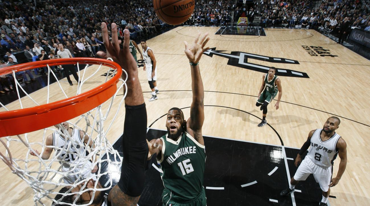 SAN ANTONIO, TX - DECEMBER 2:  Greg Monroe #15 of the Milwaukee Bucks shoots the ball against the San Antonio Spurs on December 2, 2015 at the AT&T Center in San Antonio, Texas.