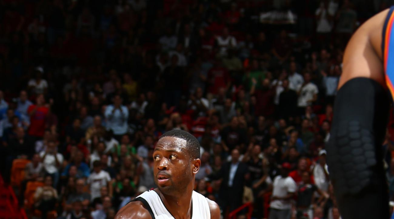 MIAMI, FL - DECEMBER 3: Dwyane Wade #3 of the Miami Heat handles the ball against the Oklahoma City Thunder on December 3, 2015 at AmericanAirlines Arena in Miami, Florida. (Photo by Nathaniel S. Butler/NBAE via Getty Images)