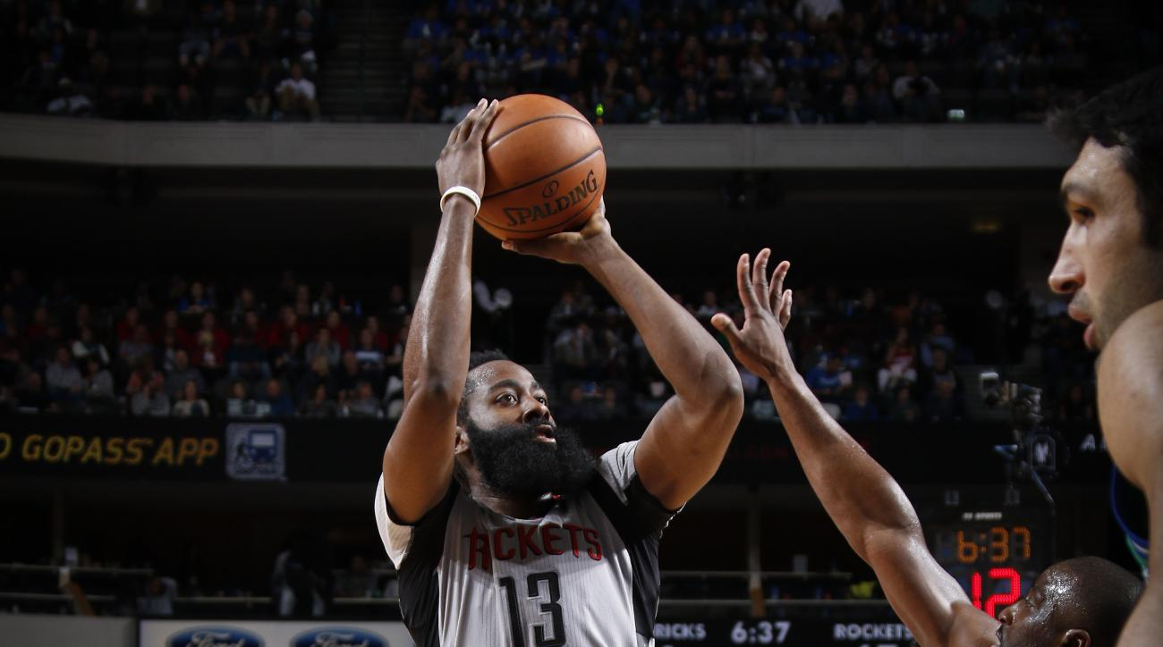 DALLAS, TX - DECEMBER 4: James Harden #13 of the Houston Rockets shoots a jumper against the Dallas Mavericks on December 4, 2015 at the American Airlines Center in Dallas, Texas. (Photo by Glenn James/NBAE via Getty Images)