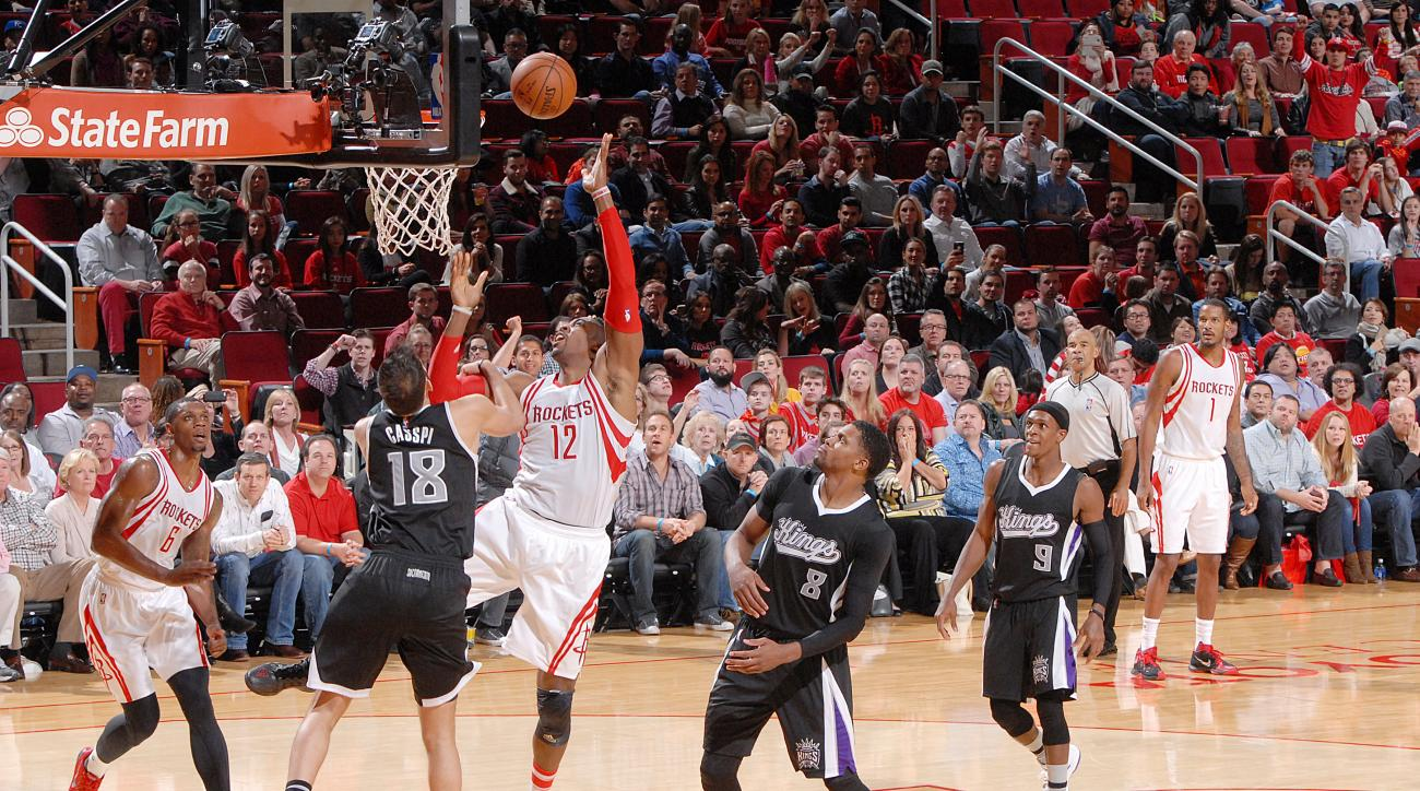 HOUSTON, TX - DECEMBER 5:  Dwight Howard #12 of the Houston Rockets shoots the ball against the Sacramento Kings on December 5, 2015 at the Toyota Center in Houston, Texas. (Photo by Bill Baptist/NBAE via Getty Images)