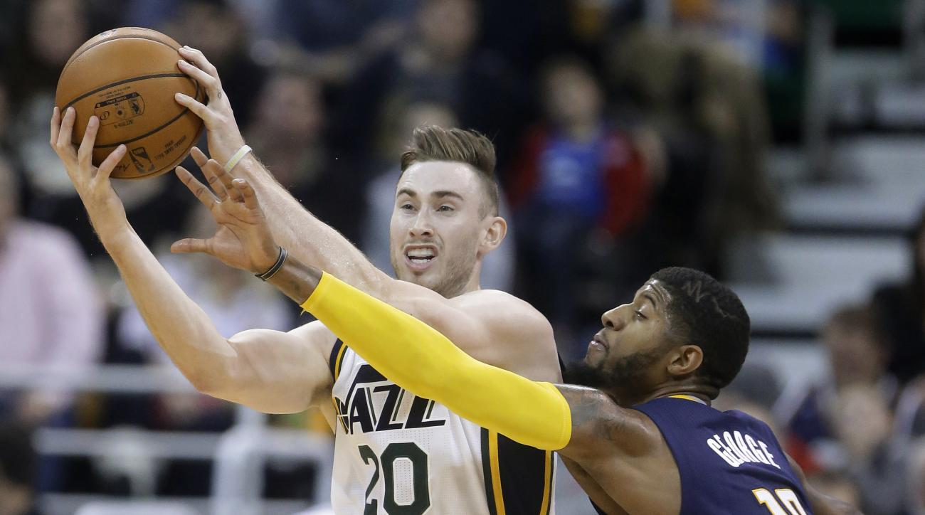 Indiana Pacers forward Paul George (13) attempts to steal the ball from Utah Jazz forward Gordon Hayward (20) during the second half of an NBA  basketball game Saturday, Dec. 5, 2015, in Salt Lake City. Utah won 122-119 in overtime. (AP Photo/Rick Bowmer)