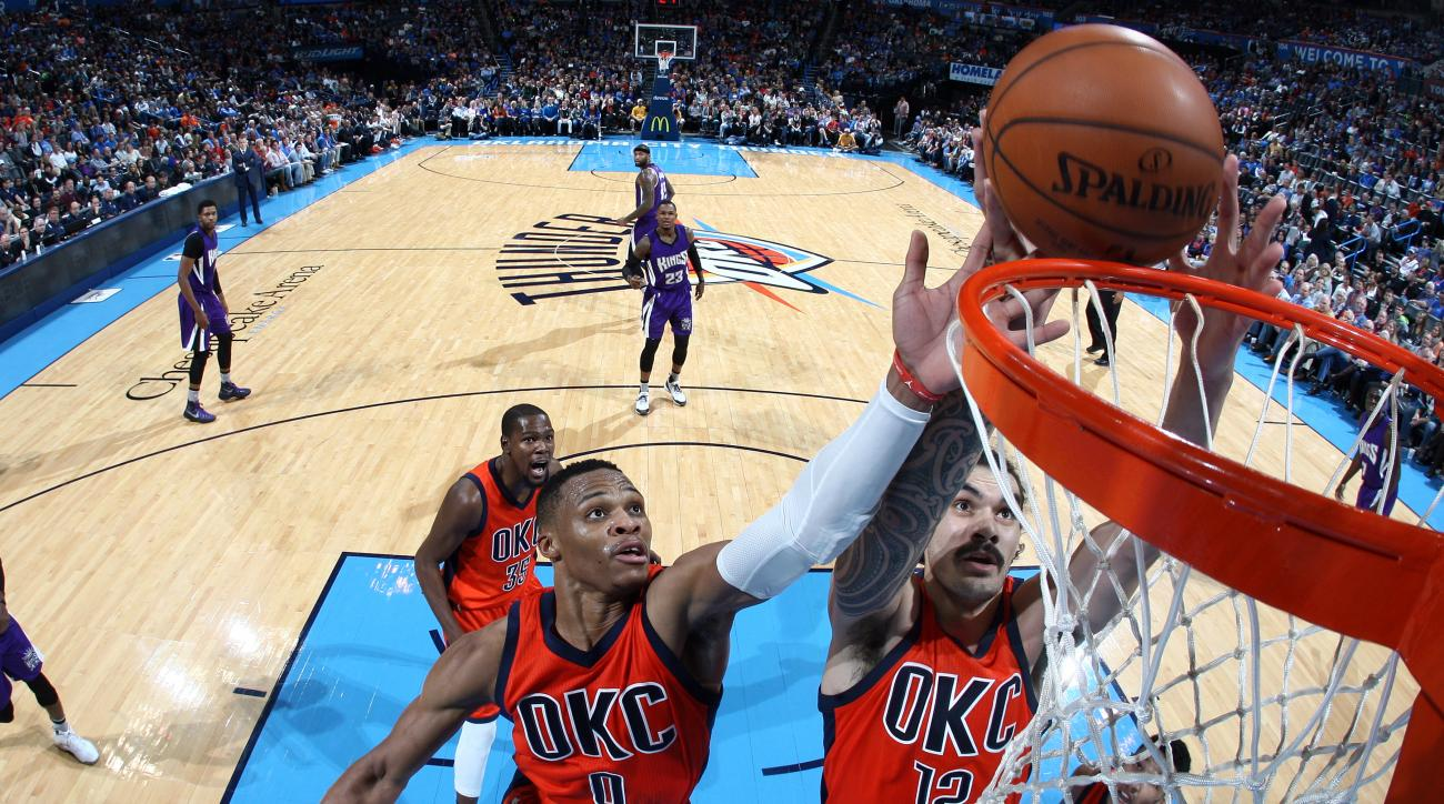 OKLAHOMA CITY, OK- DECEMBER 6: Russell Westbrook #0 and Steven Adams #12 of the Oklahoma City Thunder grabs the rebound against the Sacramento Kings on December 6, 2015 at Chesapeake Energy Arena in Oklahoma City, Oklahoma. (Photo by Layne Murdoch/NBAE vi