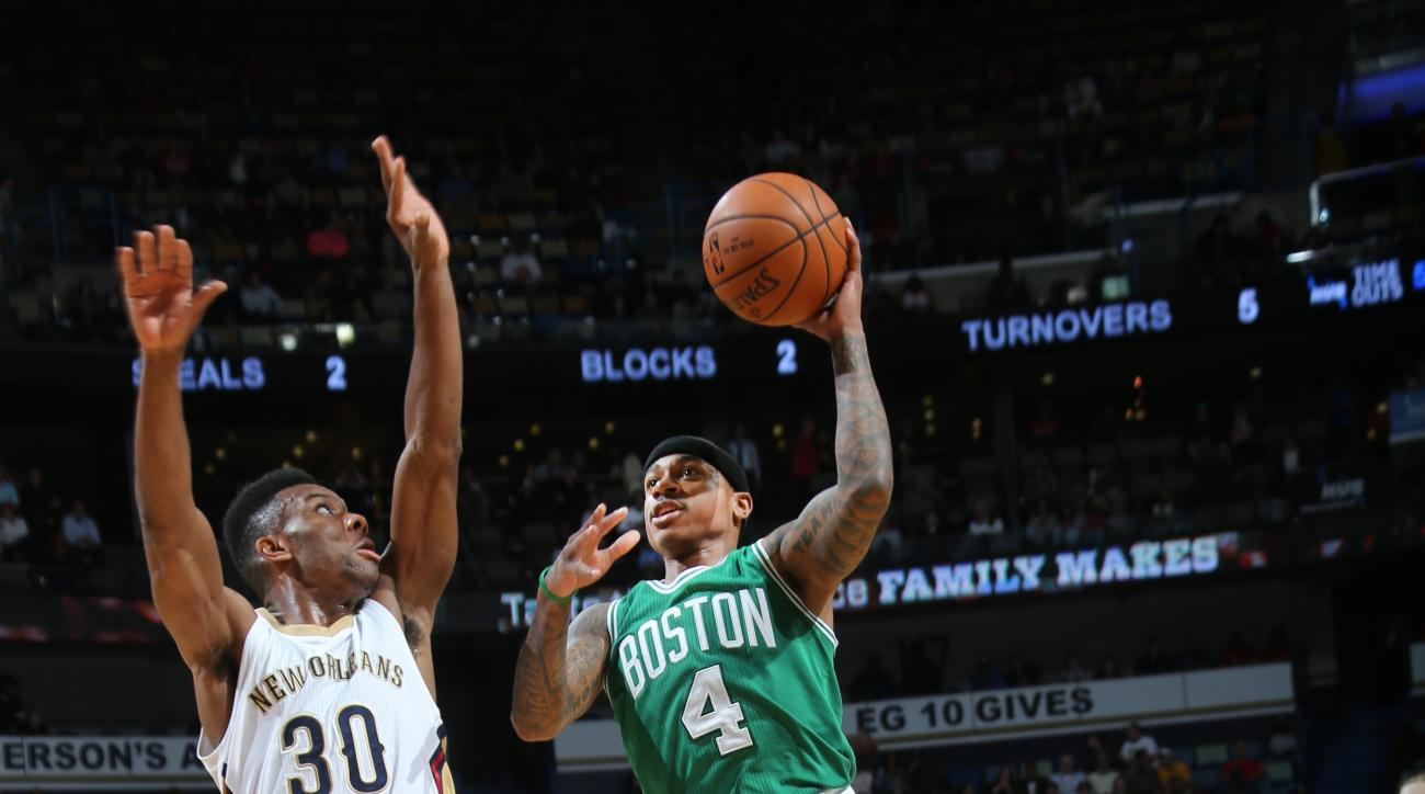 NEW ORLEANS, LA - DECEMBER 7:  Isaiah Thomas #4 of the Boston Celtics shoots the ball against Norris Cole #30 of the New Orleans Pelicans on December 7, 2015 at Smoothie King Center in New Orleans, Louisiana. (Photo by Layne Murdoch/NBAE via Getty Images)