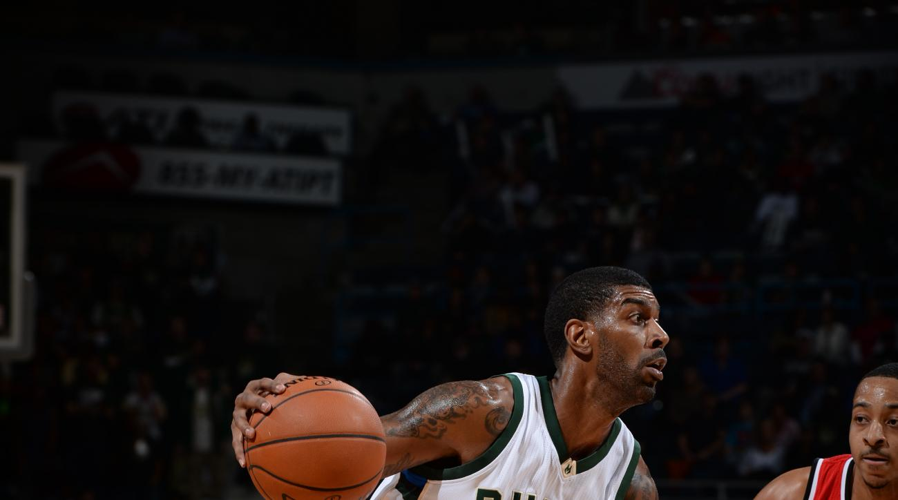 MILWAUKEE, WI - DECEMBER 7:  O.J. Mayo #3 of the Milwaukee Bucks drives to the basket against the Portland Trail Blazers on December 7, 2015 at the BMO Harris Bradley Center in Milwaukee, Wisconsin. (Photo by Garrett Ellwood/NBAE via Getty Images)
