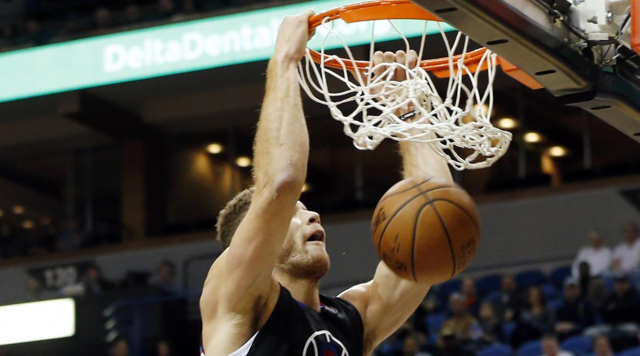 Los Angeles Clippers' Blake Griffin dunks as Minnesota Timberwolves' Karl-Anthony Towns, left, looks on in the second half of an NBA basketball game, Monday, Dec. 7, 2015, in Minneapolis. The Clippers won 110-106. (AP Photo/Jim Mone)