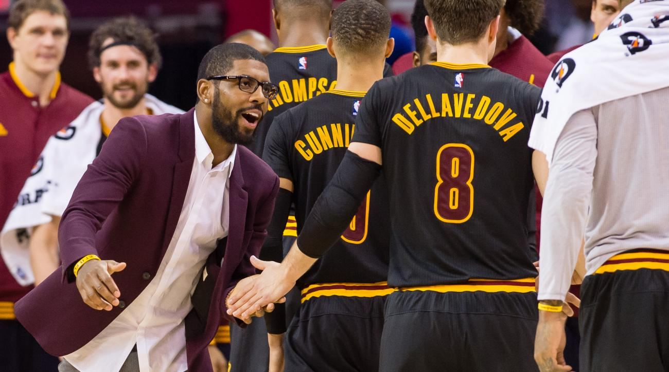 CLEVELAND, OH - DECEMBER 8: Kyrie Irving #2 of the Cleveland Cavaliers celebrates with his teammates as they walk off the court during a timeout during the second half against the Portland Trail Blazers at Quicken Loans Arena on December 8, 2015 in Clevel