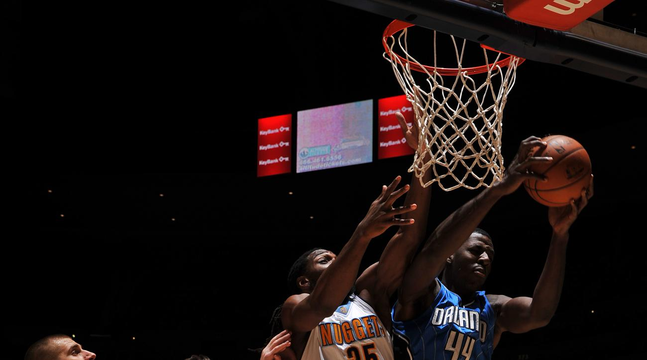 DENVER, CO - DECEMBER 8:  Andrew Nicholson #44 of the Orlando Magic grabs the rebound against Kenneth Faried #35 of the Denver Nuggets on December 8, 2015 at the Pepsi Center in Denver, Colorado. (Photo by Bart Young/NBAE via Getty Images)