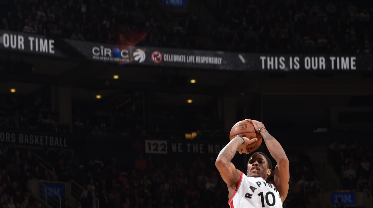 TORONTO, CANADA - DECEMBER 9:  DeMar DeRozan #10 of the Toronto Raptors shoots against Manu Ginobili #20 of the San Antonio Spurs on December 9, 2015 at the Air Canada Centre in Toronto, Ontario, Canada.  (Photo by Ron Turenne/NBAE via Getty Images)
