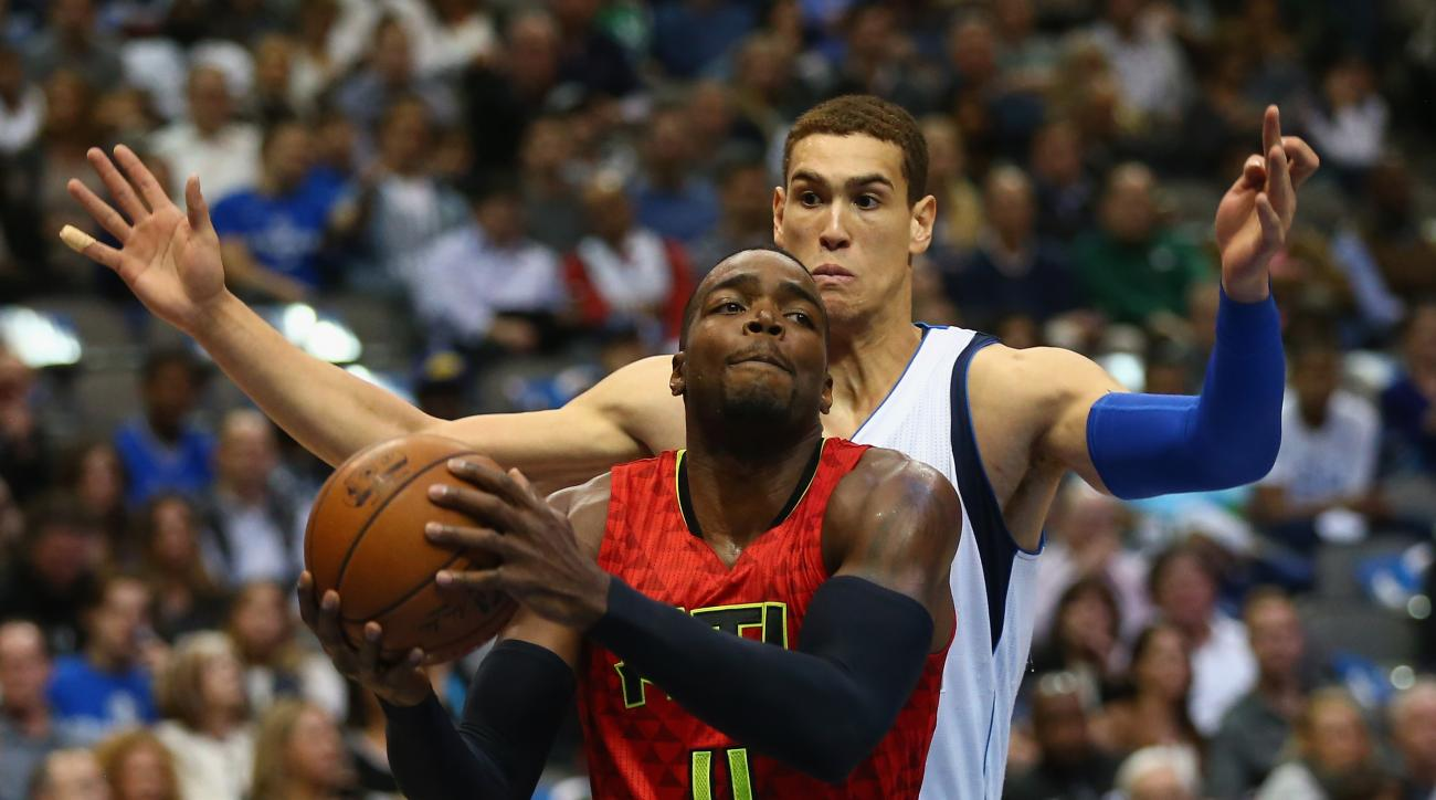 DALLAS, TX - DECEMBER 09:  Paul Millsap #4 of the Atlanta Hawks dribbles the ball past Dwight Powell #7 of the Dallas Mavericks American Airlines Center on December 9, 2015 in Dallas, Texas.  (Photo by Ronald Martinez/Getty Images)