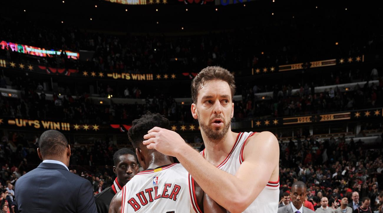 CHICAGO, IL - DECEMBER 10:  Pau Gasol #16 of the Chicago Bulls hugs Jimmy Butler #21 of the Chicago Bulls after the game against the Los Angeles Clippers on December 10, 2015 at the United Center in Chicago, Illinois. (Photo by Andrew D. Bernstein/NBAE vi