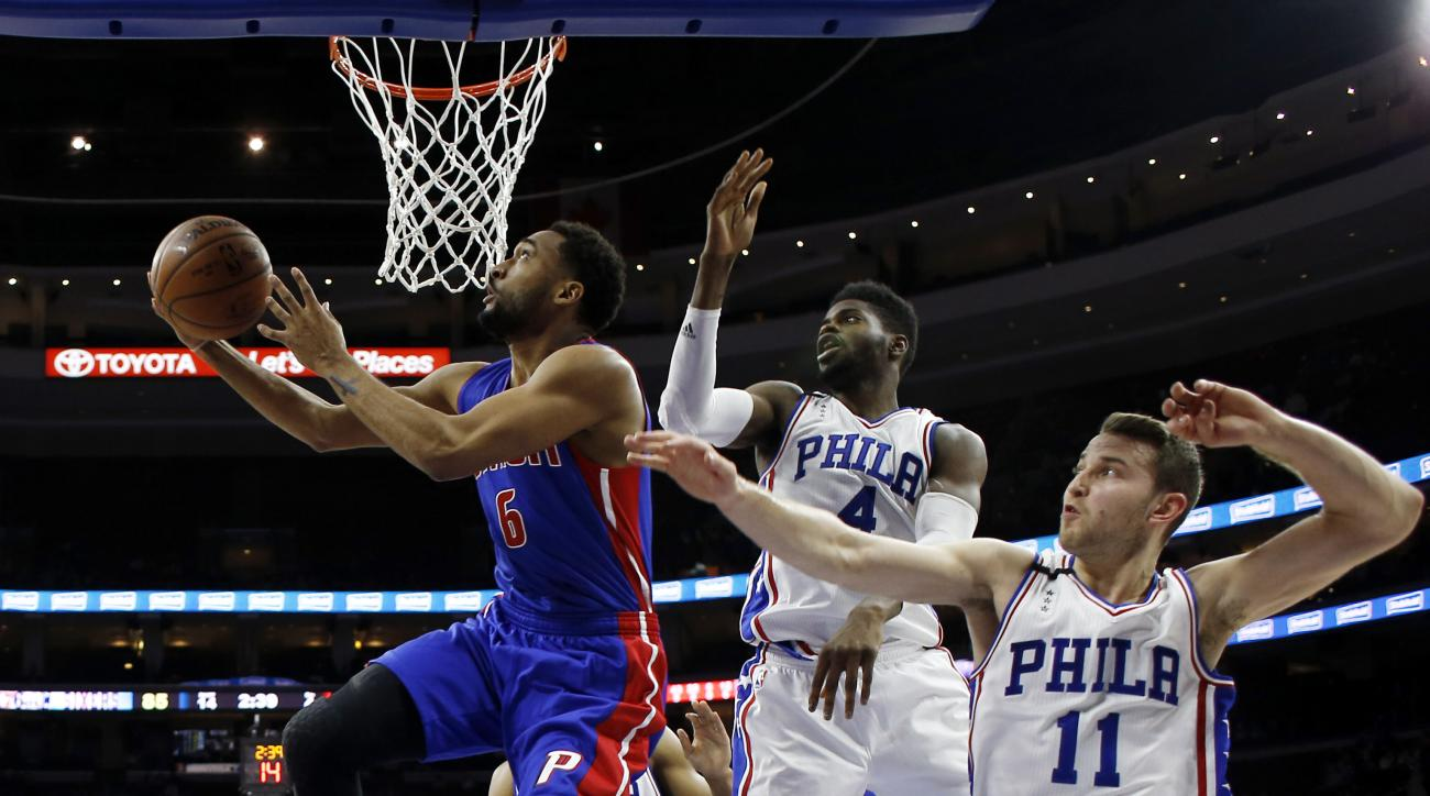 Detroit Pistons' Darrun Hilliard (6) goes up for a shot against Philadelphia 76ers' Nerlens Noel (4) and Nik Stauskas (11) during the second half of an NBA basketball game, Friday, Dec. 11, 2015, in Philadelphia. Detroit won 107-95. (AP Photo/Matt Slocum)
