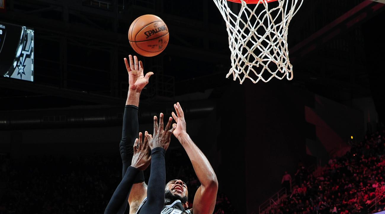ATLANTA, GA - DECEMBER 12: Kawhi Leonard #2 of the San Antonio Spurs shoots the ball during the game against the Atlanta Hawks on December 12, 2015 at Philips Arena in Atlanta, Georgia.  (Photo by Scott Cunningham/NBAE via Getty Images)