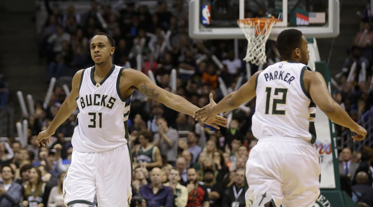 MILWAUKEE, WI - DECEMBER 12: Jabari Parker #12 of the Milwaukee Bucks celebrates with John Henson #31 after making a basket during the third quarter against the Golden State Warriors at BMO Harris Bradley Center on December 12, 2015 in Milwaukee, Wisconsi