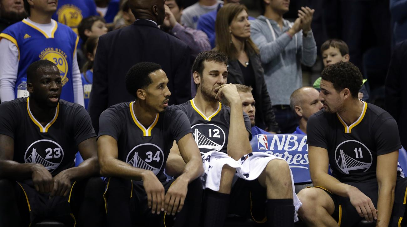 Golden State Warriors' Andrew Bogut (12), Klay Thompson (11), Shaun Livingston (34), and Draymond Green (23) talk on the bench during the second half of an NBA basketball game against the Milwaukee Bucks Saturday, Dec. 12, 2015, in Milwaukee. The Bucks wo