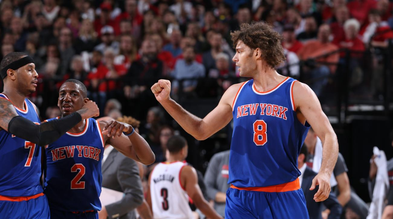 PORTLAND, OR - DECEMBER 12:  Carmelo Anthony #7 of the New York Knicks and Robin Lopez #8 of the New York Knicks celebrate during the game against the Portland Trail Blazers on December 12, 2015 at the Moda Center in Portland, Oregon. (Photo by Sam Forenc