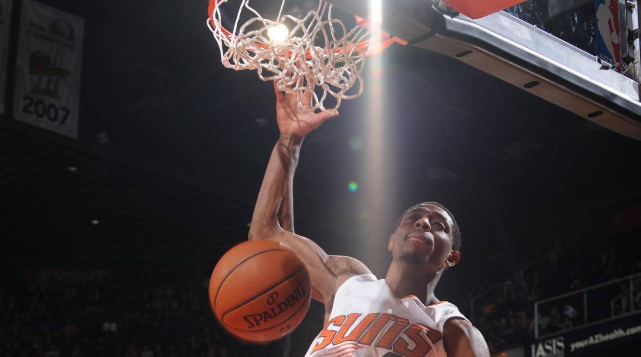 PHOENIX, AZ - DECEMBER 13: Brandon Knight #3 of the Phoenix Suns dunks against the Minnesota Timberwolves on December 13, 2015, at Talking Stick Resort Arena in Phoenix, Arizona. (Photo by Barry Gossage/NBAE via Getty Images)