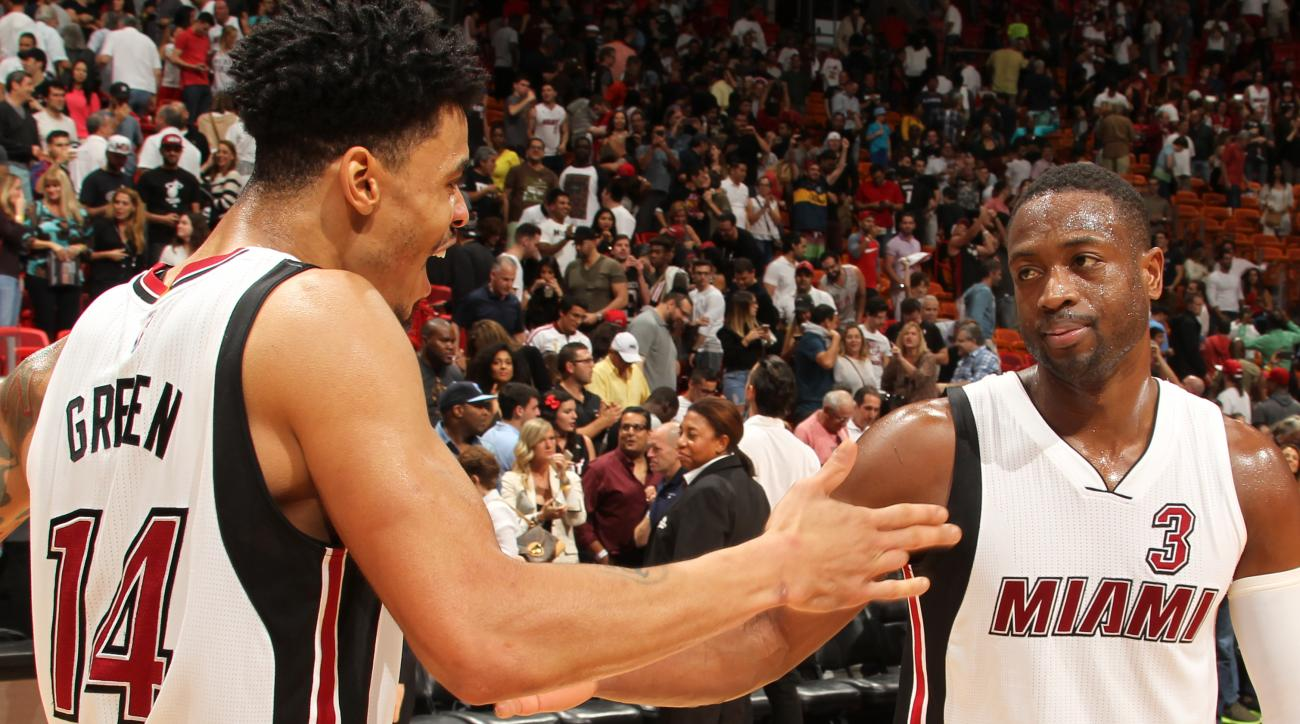 MIAMI, FL - DECEMBER 13: Gerald Green #14 and Dwyane Wade #3 of the Miami Heat after the game against the Memphis Grizzlies on December 13, 2015 at American Airlines Arena in Miami, Florida. (Photo by Issac Baldizon/NBAE via Getty Images)