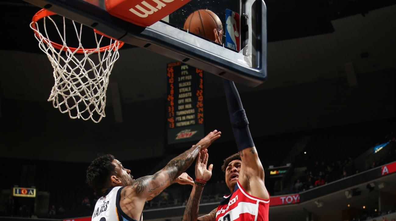 MEMPHIS, TN - DECEMBER 14: Kelly Oubre Jr. #12 of the Washington Wizards goes for the lay up against Matt Barnes #22 of the Memphis Grizzlies during the game on December 14, 2015 at FedExForum in Memphis, Tennessee. (Photo by Joe Murphy/NBAE via Getty Ima
