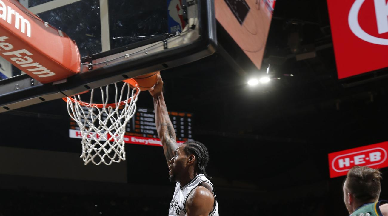 SAN ANTONIO, TX - DECEMBER 14: Kawhi Leonard #2 of the San Antonio Spurs dunks against the Utah Jazz during the game on December 14, 2015 at the AT&T Center in San Antonio, Texas.
