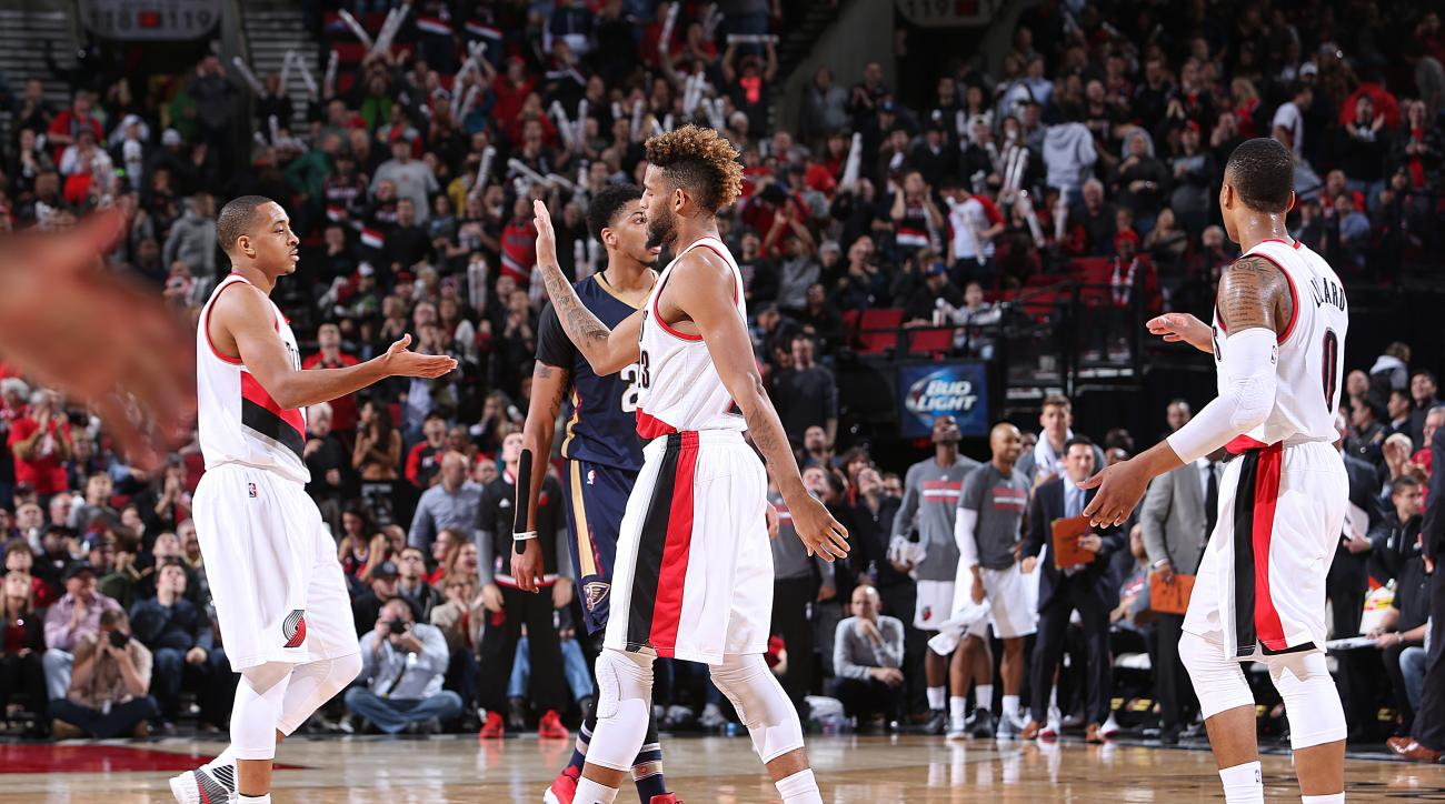 PORTLAND, OR - DECMEBER 14:  Allen Crabbe #23 of the Portland Trail Blazers shakes hands with C.J. McCollum #3 of the Portland Trail Blazers during the game against the New Orleans Pelicans on December 14, 2015 at the Moda Center in Portland, Oregon. (Pho