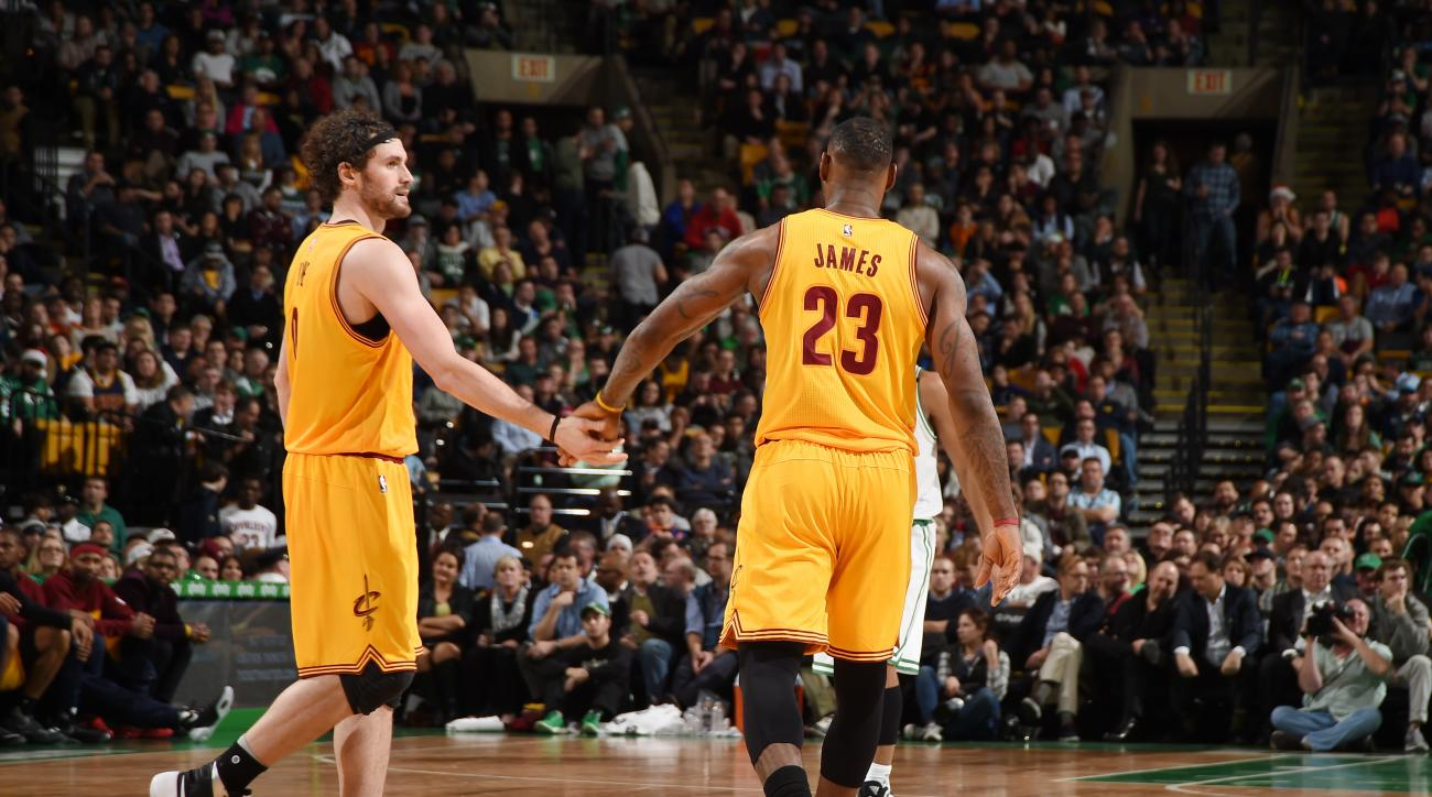 BOSTON, MA - DECEMBER 15: Kevin Love #0 of the Cleveland Cavaliers high fives teammate LeBron James #23 of the Cleveland Cavaliers during the game on December 15, 2015 at TD Garden in Boston, Massachusetts. (Photo by Brian Babineau/NBAE via Getty Images)