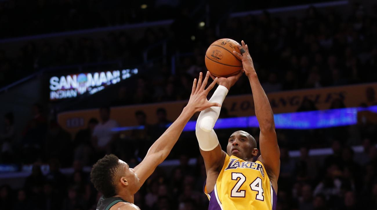 Los Angeles Lakers' Kobe Bryant shoots as Milwaukee Bucks' Giannis Antetokounmpo defends during the second half of an NBA basketball game Tuesday, Dec. 15, 2015, in Los Angeles. The Lakers won 113-95. (AP Photo/Danny Moloshok)