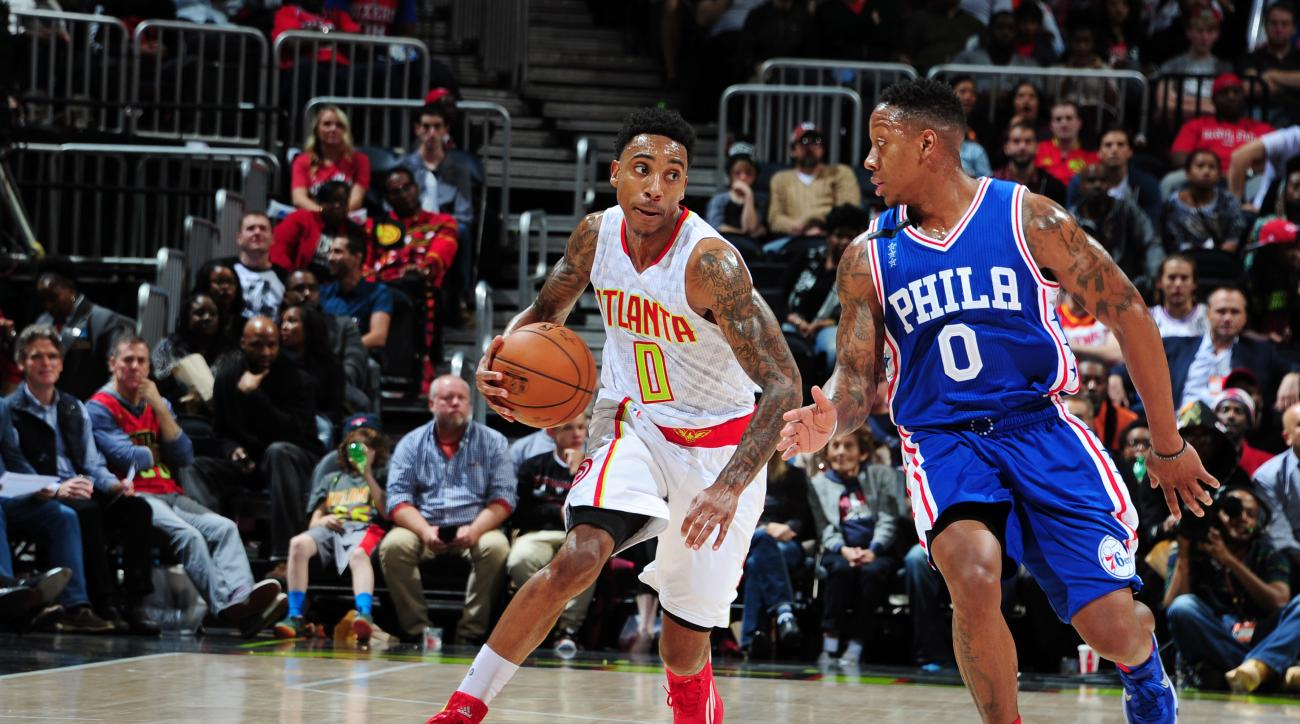 ATLANTA, GA - DECEMBER 16: Jeff Teague #0 of the Atlanta Hawks handles the ball during the game against the Philadelphia 76ers on December 16, 2015 at Philips Arena in Atlanta, Georgia.  (Photo by Scott Cunningham/NBAE via Getty Images)