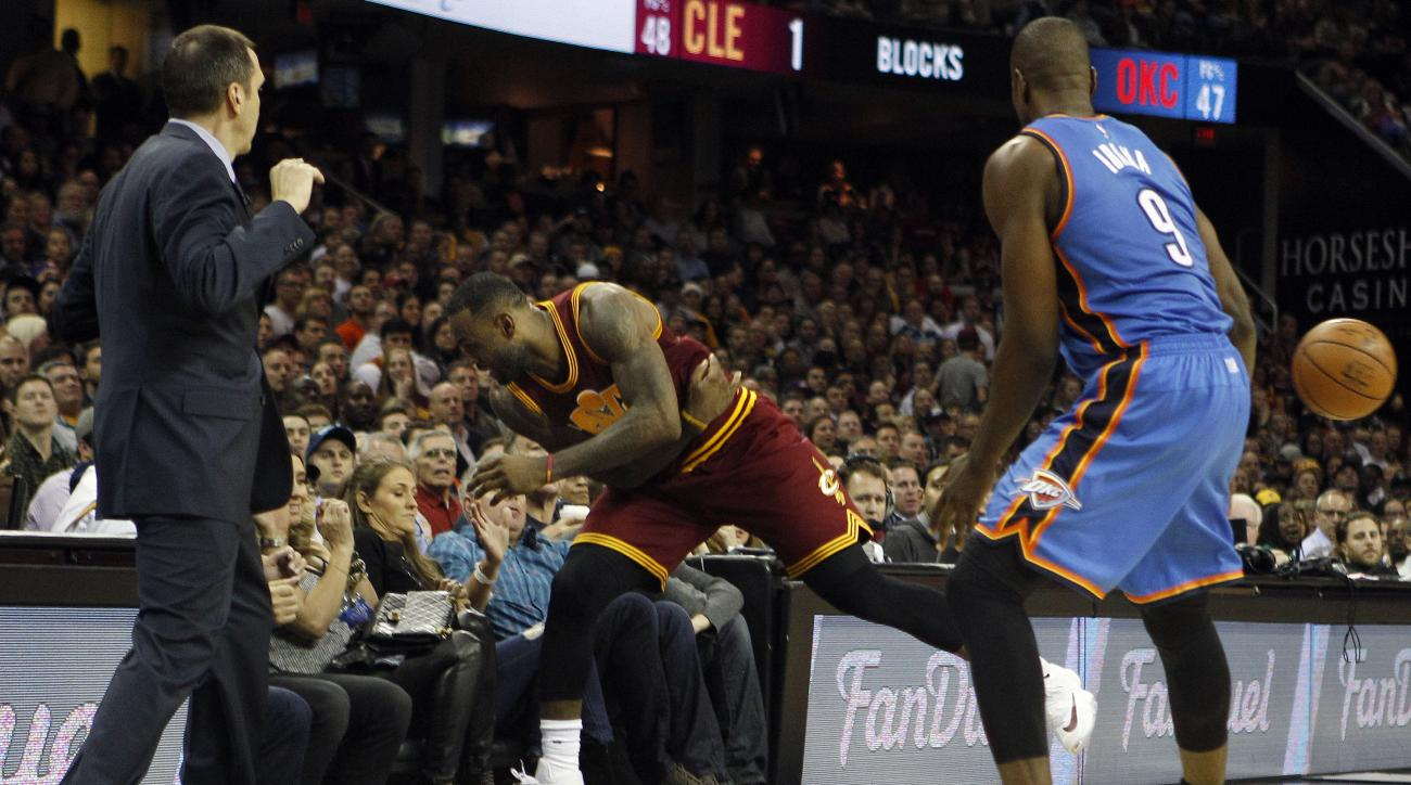 CLEVELAND, OH - DECEMBER 17:  LeBron James #23 of the Cleveland Cavaliers crashes into the stands in pursuit of a loose ball during the second half against the Oklahoma City Thunder on December 17, 2015 at Quicken Loans Arena  in Cleveland, Ohio. The Cava