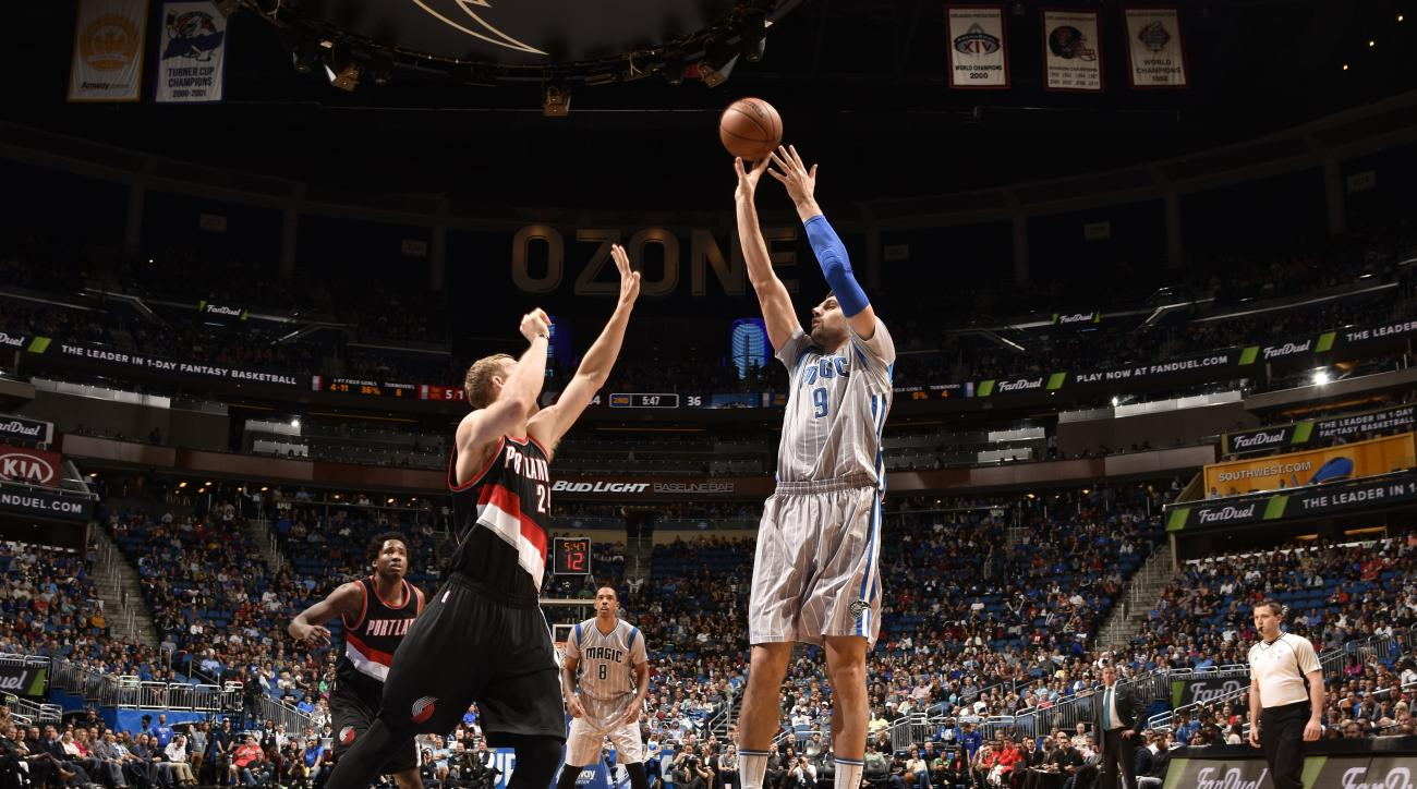 ORLANDO, FL - DECEMBER 18:  Nikola Vucevic #9 of the Orlando Magic shoots the ball against the Portland Trail Blazers on December 18, 2015 at Amway Center in Orlando, Florida. (Photo by Fernando Medina/NBAE via Getty Images)
