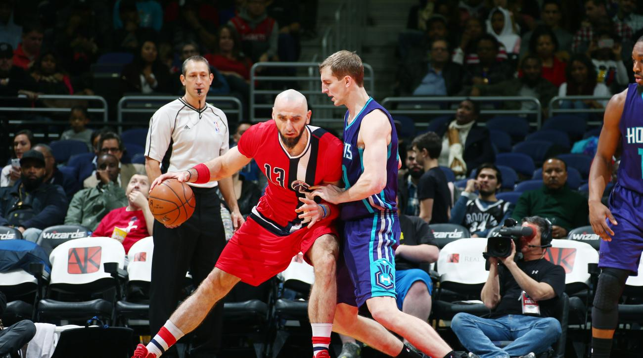 WASHINGTON, DC -  DECEMBER 19: Marcin Gortat #13 of the Washington Wizards handles the ball during the game against the Charlotte Hornets on December 19, 2015 at Verizon Center in Washington, DC. (Photo by Ned Dishman/NBAE via Getty Images)