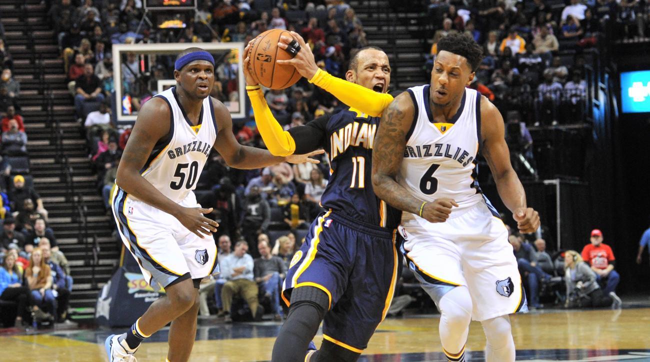 Indiana Pacers guard Monta Ellis (11) drives between Memphis Grizzlies forward Zach Randolph (50) and guard Mario Chalmers (6) in the second half of an NBA basketball game Saturday, Dec. 19, 2015, in Memphis, Tenn. (AP Photo/Brandon Dill)